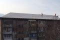 Ремонт пострадавших отпожаров крыш домов вХолмске иУглегорске идет поплану