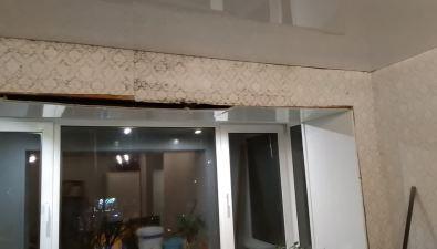 В доме №242 поулице Ленина вЮжно-Сахалинске идет дождь изтающего снега