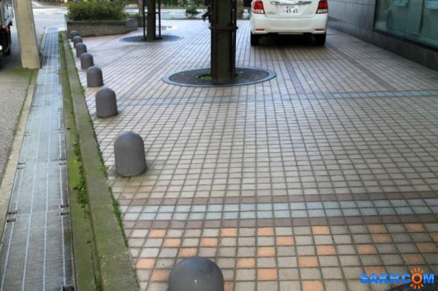 тротуар, ливневка и дорога в Тояма