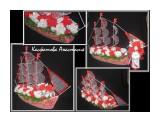 """парусник Парусник с конфетами и бутылкой мартини - оригинальный и запоминающийся подарок. Полностью ручная работа. Такой подарок будет уместным на свадьбу, годовщину, юбилей или презент начальнику, у которого все есть. длина парусника 80см, высота 60см. Можно выполнить в любой цветовой гамме, любого размера, а также """"мужской"""" вариант корабля.  Просмотров: 1612 Комментариев: 0"""