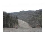 """Название: трасса по живому лесу вдоль края мёртвого леса. Фотоальбом: Трассы горы Красной Категория: Природа  Время съемки/редактирования: 2019:10:25 16:59:40 Фотокамера: NIKON - COOLPIX P330 Диафрагма: f/2.8 Выдержка: 10/1250 Фокусное расстояние: 51/10   Описание: Проигнорировав возможность построить горнолыжную трассу по лесу, выкошенному ураганом 2015 г., решили добить оставшийся живой лес по границе выкошенного участка. Причём о возможности пощадить природу было известно не только во время составления проекта освоения лесов и строительства (в 2018 г.), но и во время составления проекта всей ТОР """"Гоный воздух"""" (в 2016 г.).  Просмотров: 278 Комментариев: 0"""